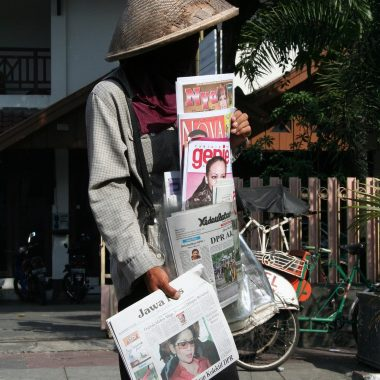 person selling newspapers