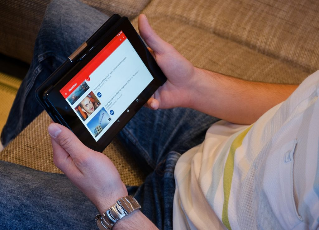 Person reading the news on ipad