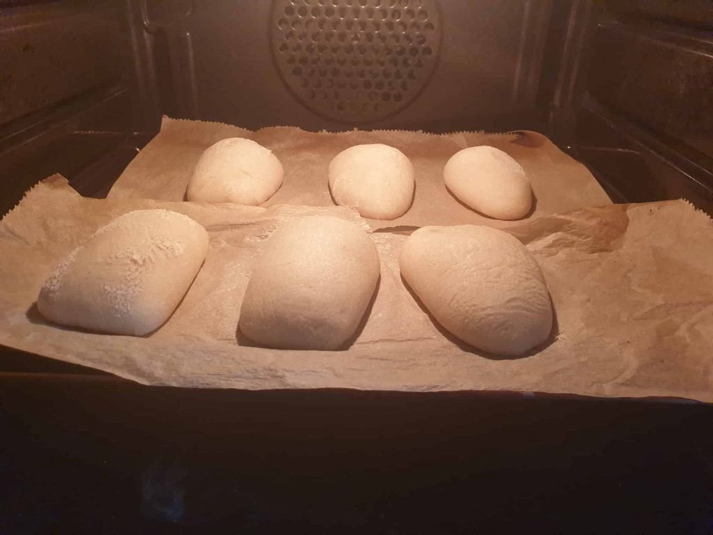 Ciabatta rolls of the first batch in the oven