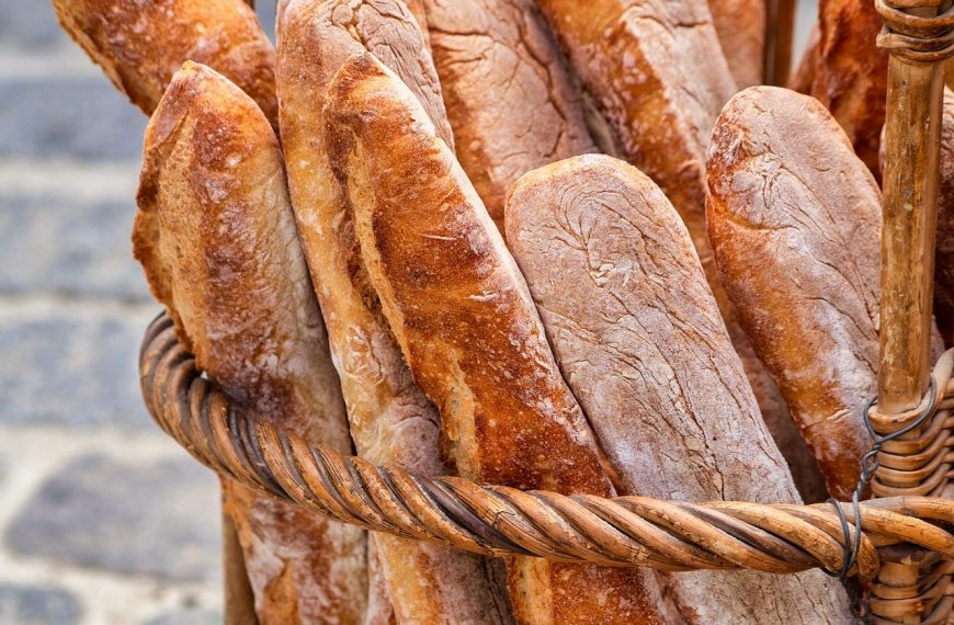 What does alpha-amylase do in bread making?